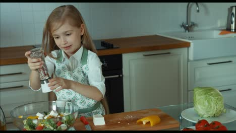 Child-Sifting-Spices-Child-Chef-In-The-Kitchen-Looking-At-Camera-And-Smiling