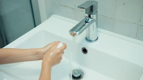 Child-Washing-His-Hands