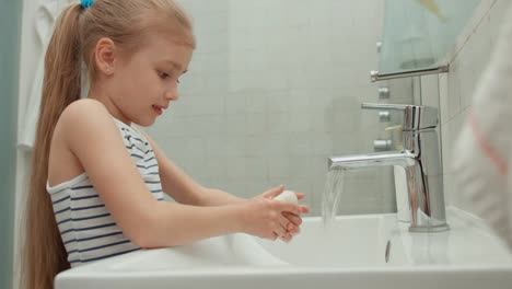 Closeup-Portrait-A-Child-Washing-His-Hands-In-The-Bathroom-Thumbs-Up-Ok