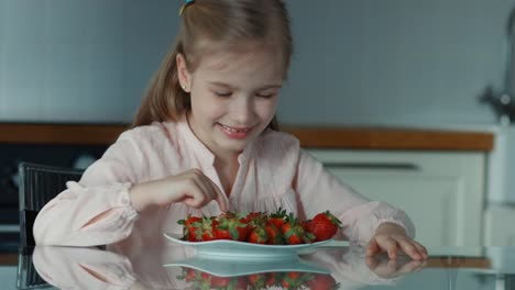 Closeup-Portrait-Child-And-A-Large-Plate-Of-Strawberries