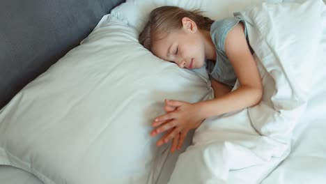 Closeup-Portrait-Girl-6-8-Years-Old-Sleeping-In-A-Bed-Top-View