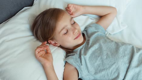 Closeup-Portrait-Girl-6-8-Years-Old-Sleeping-In-A-Bed
