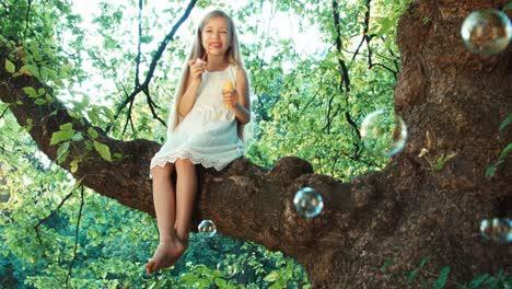 Closeup-Portrait-Girl-Blowing-Soap-Bubbles-At-Camera