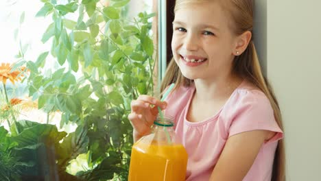 Closeup-Portrait-Girl-Drinking-Juice-And-Laughing-At-Camera