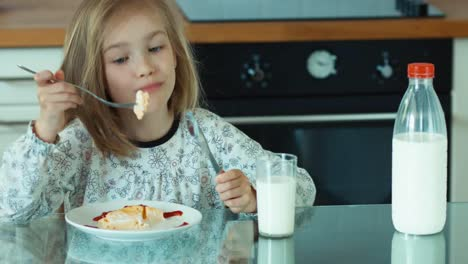 Closeup-Portrait-Girl-Eating-Eggs-And-Looking-At-Camera