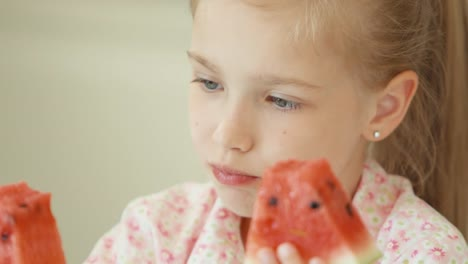 Closeup-Portrait-Girl-Eating-Watermelon-And-Looking-At-Camera