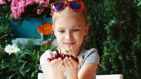 Closeup-Portrait-Girl-Reviewing-Berries-Girl-Holding-A-Handful-Cherry