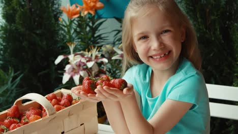 Closeup-Portrait-Girl-With-Handful-Of-Strawberries