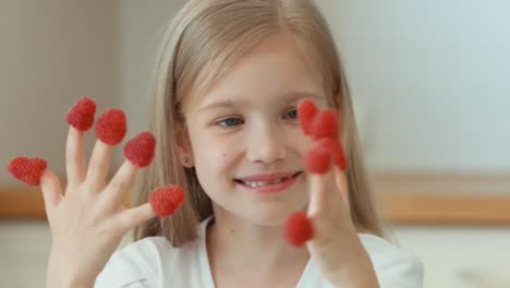 Closeup-Portrait-Girl-With-Raspberries-Child-Laughing-At-The-Camera