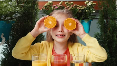 Closeup-Portrait-Laughing-Girl-Promoting-A-Healthy-Juice-Orange-Eyes