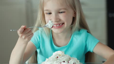 Closeup-Portrait-Of-A-Girl-Eating-Strawberries-With-Cream