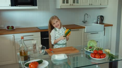 Crazy-Chef-Playing-With-Vegetables-And-Looking-At-Camera-Laughing-Girl