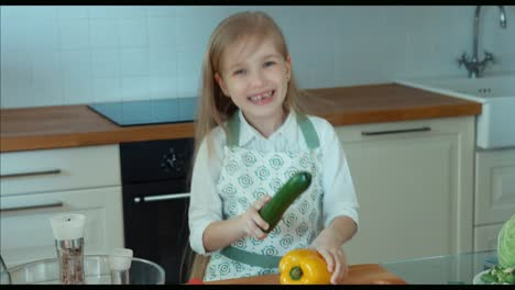 Crazy-Chef-Girl-In-The-Kitchen-Looking-At-Camera-Child-Laughing-Zooming