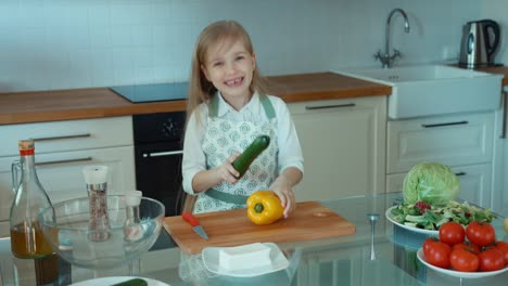 Crazy-Chef-Girl-In-The-Kitchen-Looking-At-Camera-Child-Laughing
