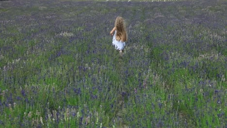 Cute-Girl-Escape-From-Camera-Across-The-Field-Child-Is-In-A-White-Dress