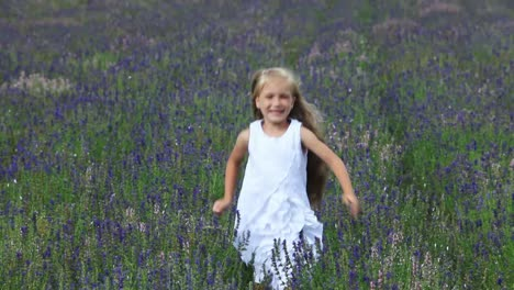Cute-Girl-Ranning-Across-The-Field-Child-Is-In-A-White-Dress