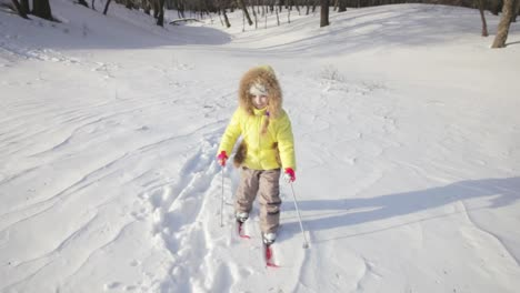 Cute-Little-Girl-On-The-Skis-Child-Making-Its-First-Steps