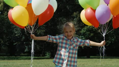 Electrified-Hair-Girl-And-A-Large-Number-Of-Balloons