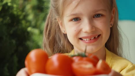 Extreme-Closeup-Portrait-Blonde-Girl-With-Bowl-Of-Tomatoes