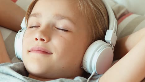 Extreme-Closeup-Portrait-Girl-Listening-Music-In-Headphones-With-Eyes-Closed