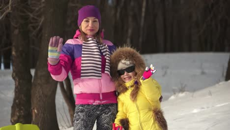 Family-In-The-Snow-Covered-Mountains-They-Are-Waving-And-Smiling-At-Camera