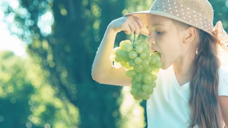 Farmer-Girl-Eating-Grape-From-Bunch-Of-Grapes-And-Laughing-At-Camera-Thumbs-Up