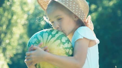 Farmer-Girl-Kissing-And-Hugging-Watermelon-Child-Claps-His-Hand-Over-Watermelon