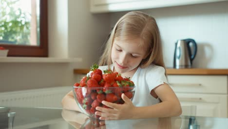 Girl-Admiring-A-Large-Plate-Of-Strawberries-And-Looking-At-Camera-Thumb-Up-Ok