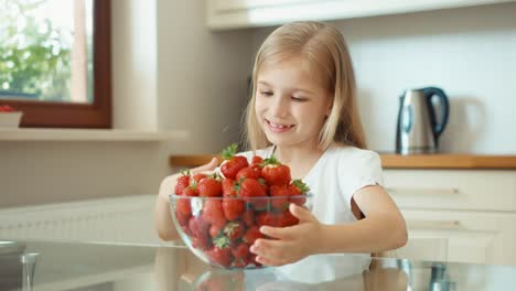 Girl-Admiring-A-Large-Plate-Of-Strawberries-And-Looking-At-Camera-Thumbs-Up-Ok