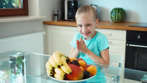 Girl-Advertises-Fruit-Girl-Rubs-His-Hands-Girl-With-A-Big-Plate-Of-Fruits