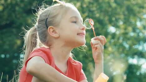 Girl-Blowing-Bubbles-In-The-Lens-Flare-Of-Sunlight-Child-Catching-Soap-Bubbles