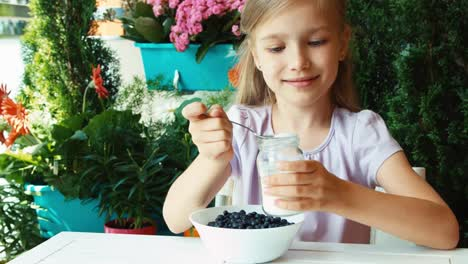 Girl-Blueberries-Sprinkled-With-Sugar-Child-Resting-In-The-Garden