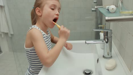 Girl-Carefully-Brushing-His-Teeth-After-Eating