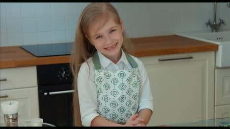 Girl-Chef-In-The-Kitchen-Looking-At-Camera-And-Smiling-Thumbs-Up-Ok-Panning