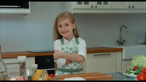 Girl-Chef-In-The-Kitchen-Looking-At-Camera-And-Smiling-Zooming