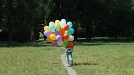 Girl-Child-Runs-Away-With-Balloons-On-A-Footpath-In-The-Meadow