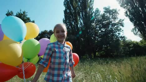Girl-Child-Spinning-With-Balloons-Against-The-Sky-In-The-Sunlight
