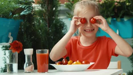 Girl-Dabbles-With-Cherry-Tomatoes-Instead-Eye-Tomatoes-Looking-And-Smiling
