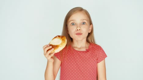 Girl-Eating-A-Cake-With-Cheese-And-Showing-It-On-The-Camera