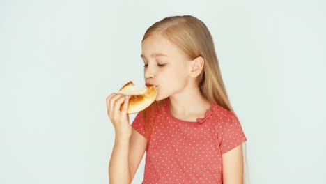 Girl-Eating-A-Cake-With-Cheese-Child-On-The-White-Background-Closeup-Thumb-Up