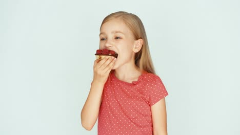 Girl-Eating-A-Cake-With-Raspberries-On-The-White-Background