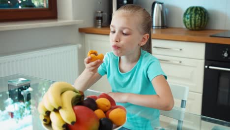 Girl-Eating-Apricot-Child-Sitting-In-The-Kitchen-Table-Thumb-Up-Ok