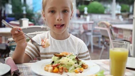Girl-Eating-Big-Shrimp-In-A-Restaurant-She-Loves-Fish-Restaurant