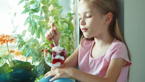 Girl-Eating-Ice-Cream-Against-Window
