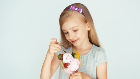 Girl-Eating-Ice-Cream-And-Smiling-At-The-Camera