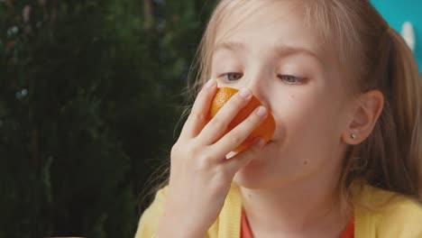 Girl-Eating-Orange-Thumb-Up-Ok-Zooming