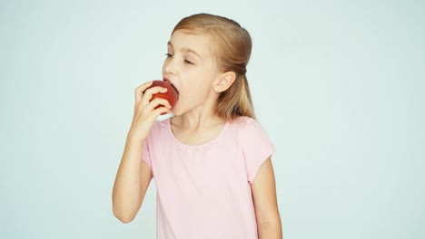 Girl-Eating-Peach-And-Kissing-It-On-The-White-Background