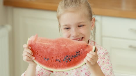 Girl-Eating-Watermelon-And-Smiling-At-The-Camera
