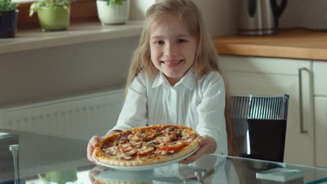 Girl-Holding-A-Big-Beautiful-Pizza-And-Looking-At-Camera