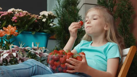 Girl-Holding-A-Huge-Plate-Of-Strawberries-And-Eating-It